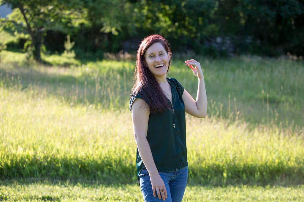spiritual business coach on a field of grass